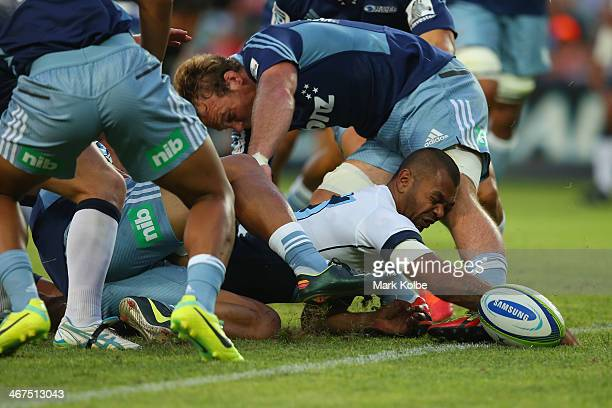 Kurtley Beale of the Waratahs scores a try during the Super Rugby trial match between the Waratahs and the Blues at Allianz Stadium on February 7...
