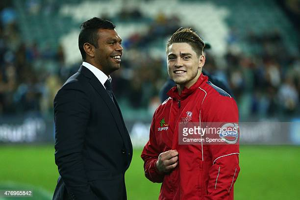 Kurtley Beale of the Waratahs talks to James O'Connor of the Reds following the round 18 Super Rugby match between the Waratahs and the Reds at...