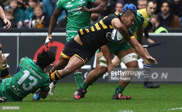 Kurtley Beale of Wasps dives over for the first try on his Wasps's debut during the European Champions Cup match between Wasps and Connacht at the...