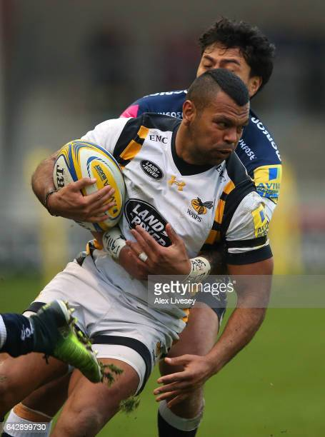 Kurtley Beale of Wasps is tackled by Denny Solomona of Sale Sharks during the Aviva Premiership match between Sale Sharks and Wasps at AJ Bell...