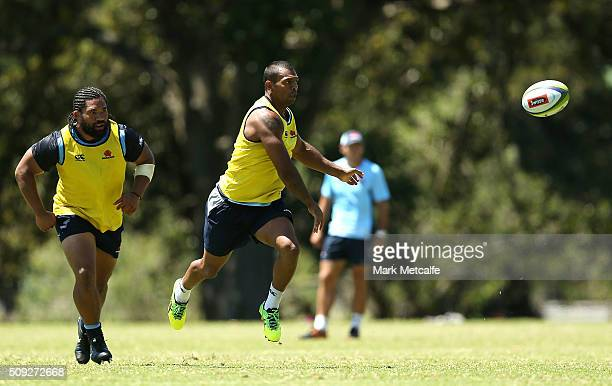 Kurtley Beale passes during a Waratahs Super Rugby training session at Kippax Lake on February 10 2016 in Sydney Australia