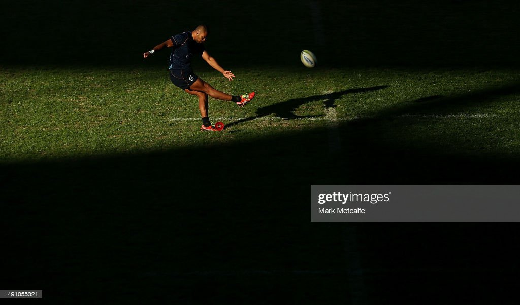 Kurtley Beale practises place kicks during a Waratahs Super Rugby Captain's Run at Allianz Stadium on May 16 2014 in Sydney Australia