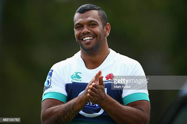 Kurtley Beale shares a joke with a team mate during a Waratahs Super Rugby training session at Allianz Stadium on February 10 2015 in Sydney Australia