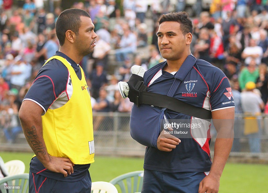 Kurtley Beale talks with Cooper Vuna of the Rebels during the Super Rugby trial match between the Waratahs and the Rebels at North Hobart Stadium on February 2, 2013 in Hobart, Australia.