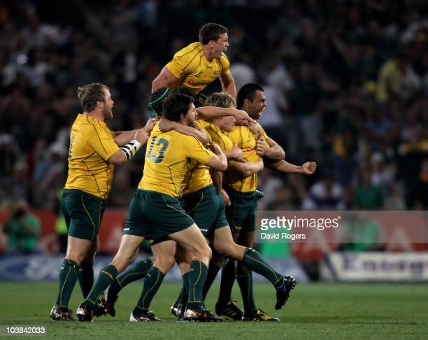 Kurtley Beale the Wallaby fullback is mobbed by team mates after scoring the last minute match winning penalty during the 2010 TriNations match...