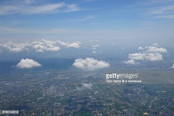 Kurume city and Chikugo River day time aerial view from airplane
