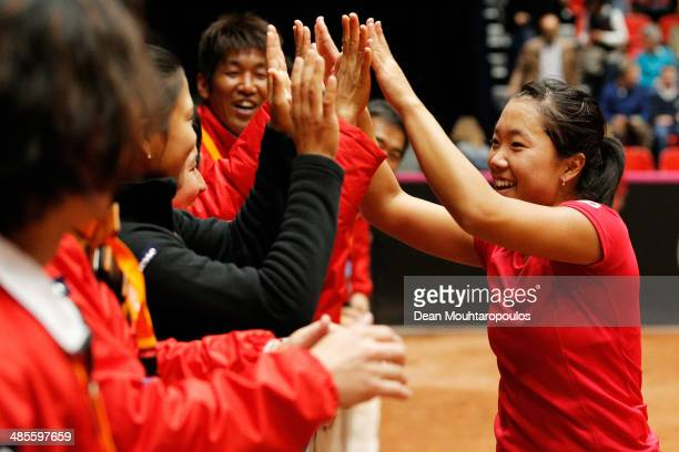 'SHERTOGENBOSCH NETHERLANDS APRIL 19 Kurumi Nara of Japan celebrates winning her match against Arantxa Rus of Netherlands with her team during the...