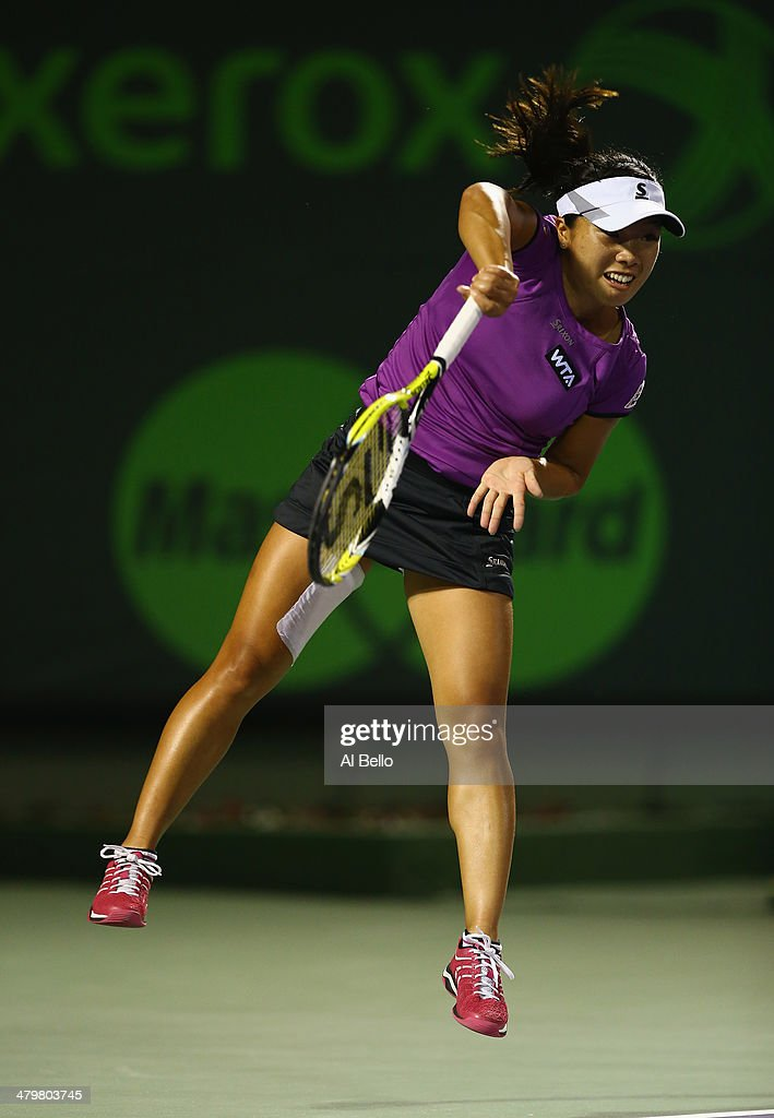 Kurumi Nara of Japan hits the ball against Maria Sharapova of Russia during their match on day 4 of the Sony Open at Crandon Park Tennis Center on March 20, 2014 in Key Biscayne, Florida.