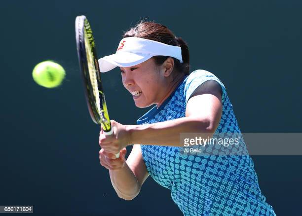 Kurumi Nara of Japan plays a backhand against Francesca Schiavone of Italy during Day 2 of the Miami Open at Crandon Park Tennis Center on March 21...