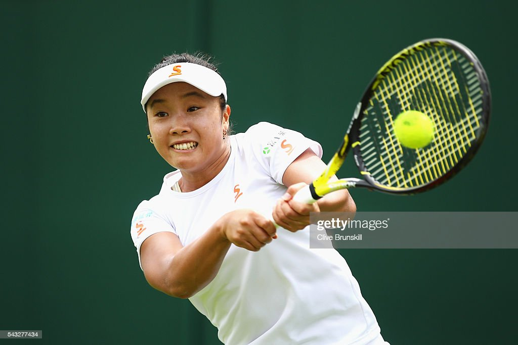 <a gi-track='captionPersonalityLinkClicked' href=/galleries/search?phrase=Kurumi+Nara&family=editorial&specificpeople=4385662 ng-click='$event.stopPropagation()'>Kurumi Nara</a> of Japan plays a backhand shot during the Ladies first round match against Madison Brengle of The United States on day one of the Wimbledon Lawn Tennis Championships at the All England Lawn Tennis and Croquet Club on June 27th, 2016 in London, England.