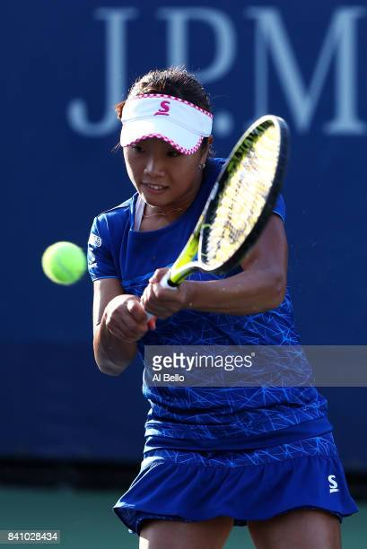 Kurumi Nara of Japan returns a shot against Sara Sorribes Tormo of Spain during their first round Women's Singles match on Day Three of the 2017 US...