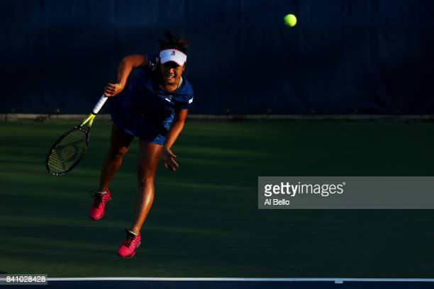 Kurumi Nara of Japan serves against Sara Sorribes Tormo of Spain during their first round Women's Singles match on Day Three of the 2017 US Open at...