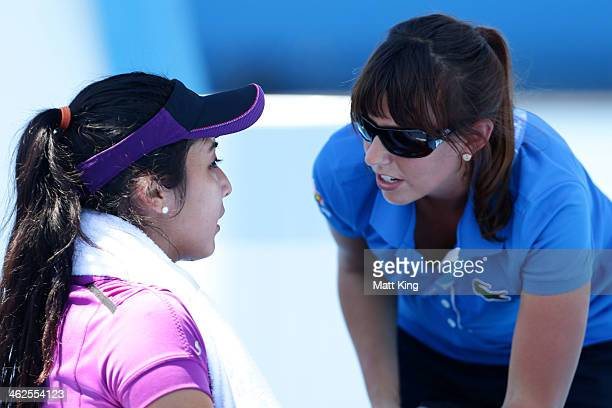 Kurumi Nara of Japan speaks to an official in her first round match against Shuai Peng of China during day two of the 2014 Australian Open at...
