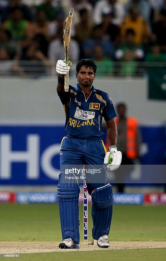 <a gi-track='captionPersonalityLinkClicked' href=/galleries/search?phrase=Kusal+Janith+Perera&family=editorial&specificpeople=7182959 ng-click='$event.stopPropagation()'>Kusal Janith Perera</a> celebrate after reaching his half century during the second Twenty20 International match between Pakistan and Sri Lanka at Dubai Sports City Cricket Stadium on December 13, 2013 in Dubai, United Arab Emirates.