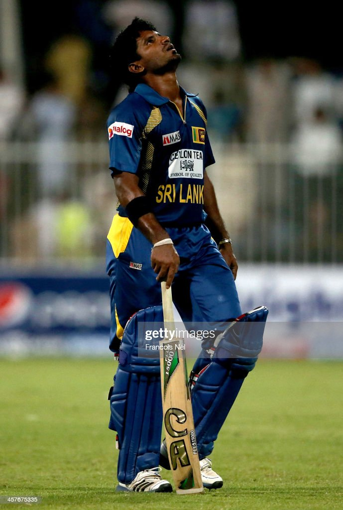 <a gi-track='captionPersonalityLinkClicked' href=/galleries/search?phrase=Kusal+Janith+Perera&family=editorial&specificpeople=7182959 ng-click='$event.stopPropagation()'>Kusal Janith Perera</a> of Sri Lanka reacts after being dismissed during the first One-Day International (ODI ) match between Sri Lanka and Pakistan at the Sharjah Cricket Stadium on December 18, 2013 in Sharjah, United Arab Emirates.