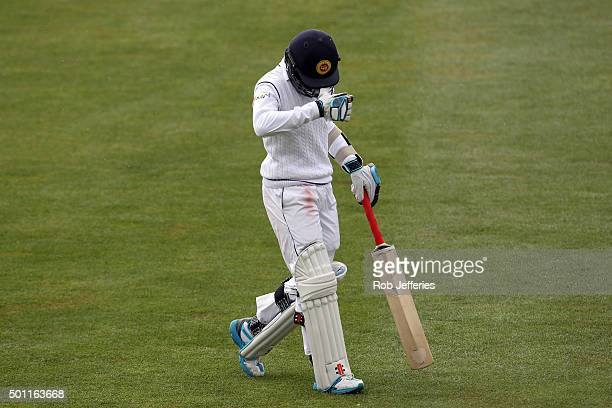 Kusal Mendis of Sri Lanka leaves the field of play after being dismissed by Tim Southee of New Zealand during day four of the First Test match...
