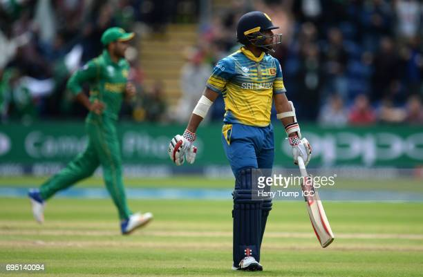 Kusal Mendis of Sri Lanka walks off after being dismissed during the ICC Champions Trophy match between Sri Lanka and Pakistan at SWALEC Stadium on...