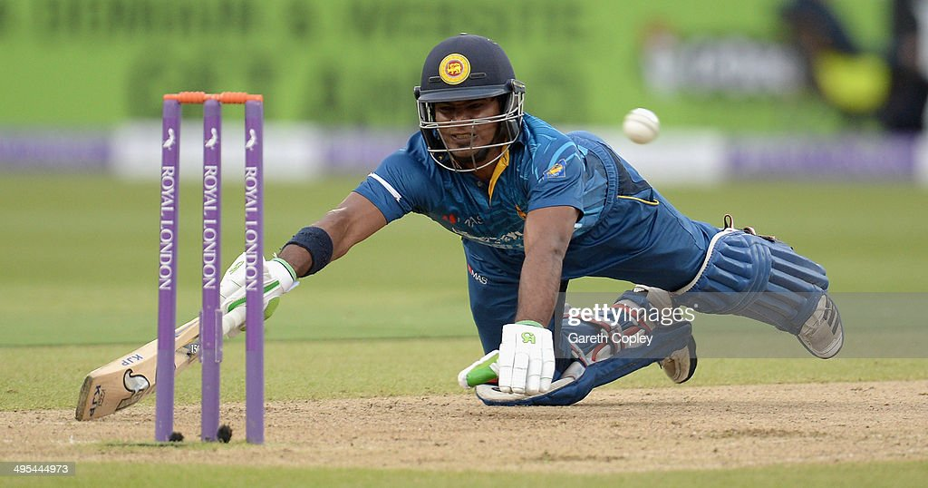 Kusal Perera of Sri Lanka dives to make his ground during the Royal London One Day International match between England and Sri Lanka at Edgbaston on June 3, 2014 in Birmingham, England.
