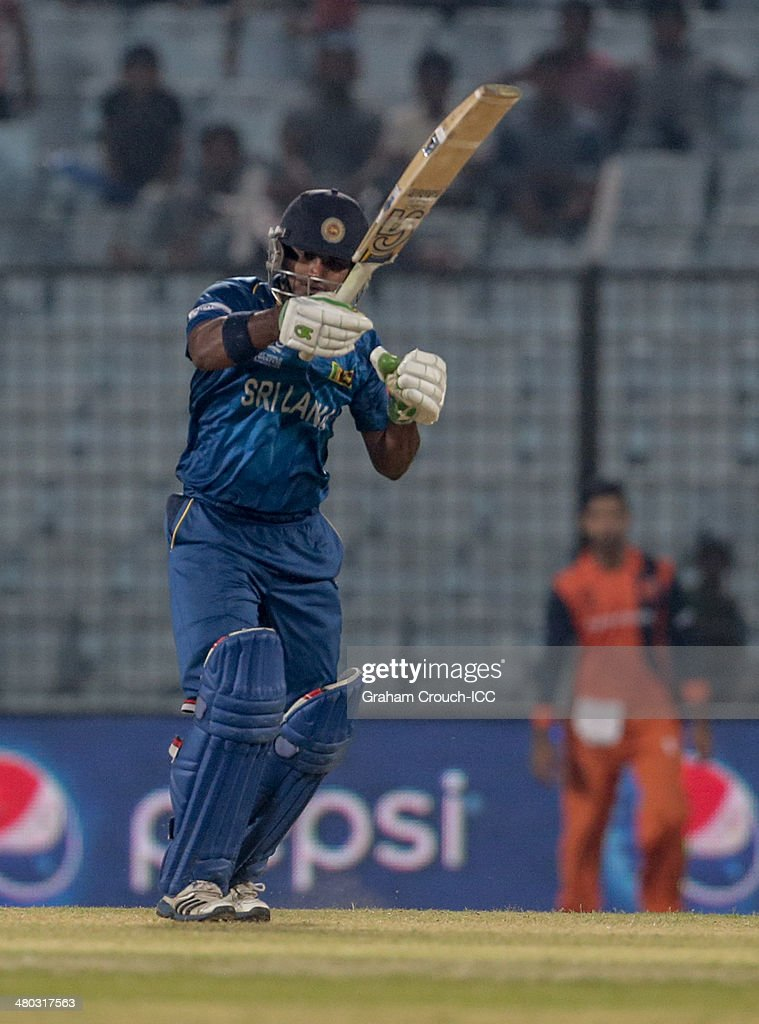 Kusal Perera of Sri Lanka gets hit on the hand first ball during the Sri Lanka v The Netherlands match at the ICC World Twenty20 Bangladesh 2014 played at Zahur Ahmed Chowdhury Stadium on March 24, 2014 in Chittagong, Bangladesh.
