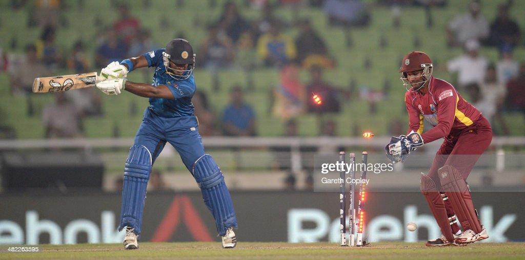 Kusal Perera of Sri Lanka is bowled by Krishmar Santokie of the West Indies during the ICC World Twenty20 Bangladesh 2014 semi final between Sri Lanka and the West Indies at Sher-e-Bangla Mirpur Stadium on April 3, 2014 in Dhaka, Bangladesh.