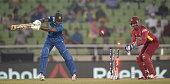 Kusal Perera of Sri Lanka is bowled by Krishmar Santokie of the West Indies during the ICC World Twenty20 Bangladesh 2014 semi final between Sri...