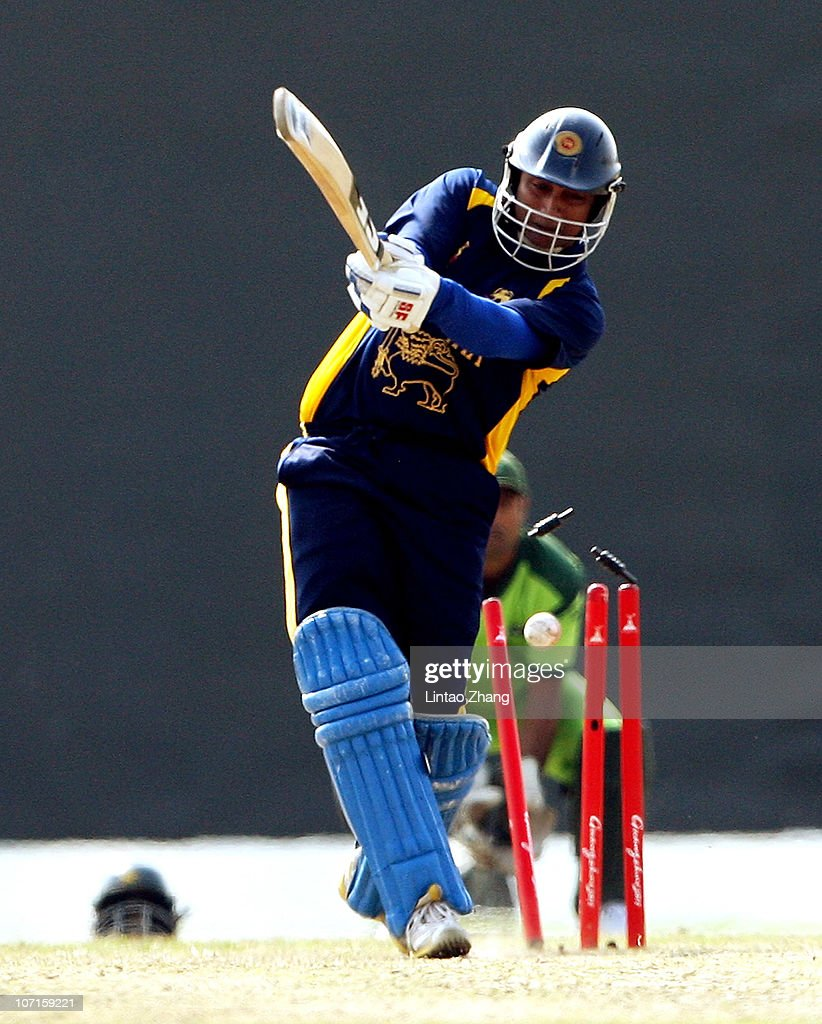 Kusal Perera of Sri Lanka is bowled out in the Men's Bronze match between Pakistan and Sri Lanka at Guanggong Cricket Stadium during day fourteen of the 16th Asian Games 2010 on November 26, 2010 in Guangzhou, China.