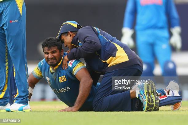 Kusal Perera of Sri Lanka receives treatment after injuring himself during the ICC Champions trophy cricket match between India and Sri Lanka at The...