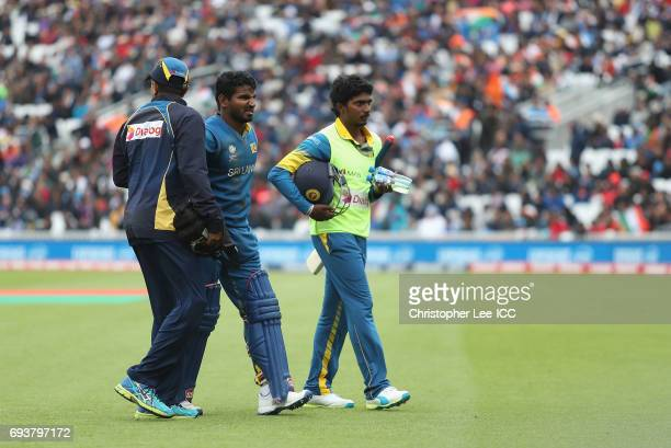 Kusal Perera of Sri Lanka retires after picking up an injury during the ICC Champions Trophy Group B match between India and Sri Lanka at The Kia...