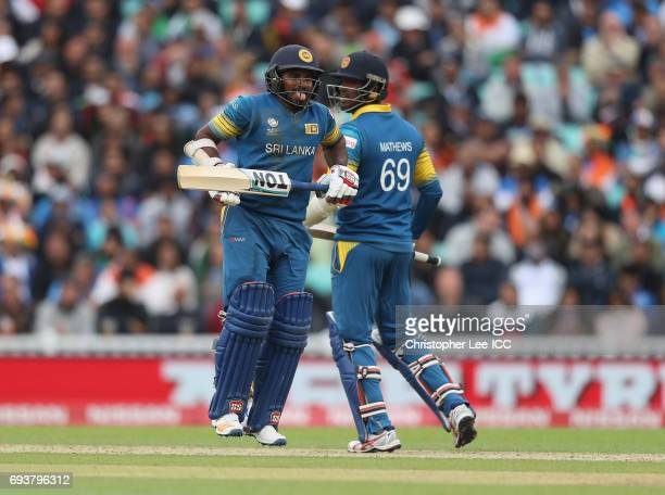 Kusal Perera of Sri Lanka struggles to run between the stumps after picking up and injury during the ICC Champions Trophy Group B match between India...