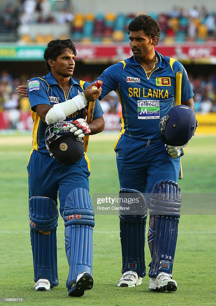 Kushal Janith Perera and <a gi-track='captionPersonalityLinkClicked' href=/galleries/search?phrase=Thisara+Perera&family=editorial&specificpeople=4884953 ng-click='$event.stopPropagation()'>Thisara Perera</a> of Sri Lanka walk from the ground after Sri Lanka defeated Australia during game three of the Commonwealth Bank One Day International Series between Australia and Sri Lanka at The Gabba on January 18, 2013 in Brisbane, Australia.