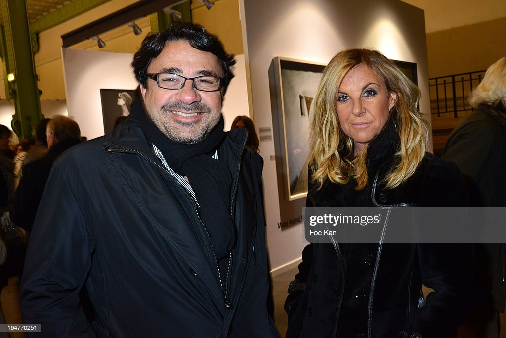 Kusmi Tea CEO Sylvain Orebi (L) and his wife attend the 'Art Paris 2013' Preview at Le Grand Palais on March 27, 2013 in Paris, France.