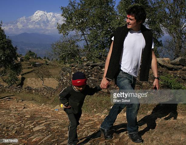 Kusum Bishwakarma age 7 escorts British actor Orlando Bloom with a red 'tikka' mark on his forehead to her home in the village of Pumdi Bhumdi on...