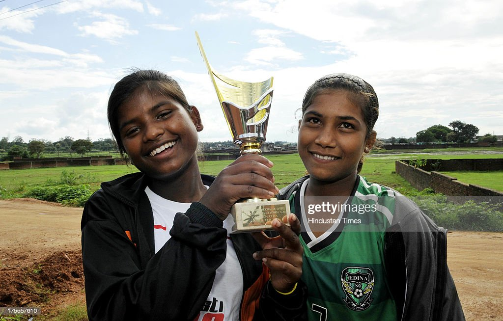 Kusum Kumari (L) and Nilmani Kumari with Gasteiz Cup 2013 they recently won in Spain belongs to the Yuwa Football Academy at Hutap village on August 2, 2013 in Ranchi, India. On July 13, the 18 tribal girls representing Yuwa India under-14 all-girls team were placed third among 10 teams playing for the Gasteiz Cup in Victoria Gasteiz in Spain. In 2012, Yuwa became the first organisation in India to win the Nike Gamechangers Award. Yuwa also won the NDTV Spirit of Sports Award, Times Now Amazing Indians Award. Set up in 2009 by Franz Gastler, its an NGO that uses football to combat child marriage and human trafficking in Jharkhands tribal belt. Gastler, a US citizen, started as an English teacher for underprivileged children when he was requested by the girls to teach them football. He formed Yuwa India, a U-14 side with girls from local villages. Having started with 15 girls in 2009, Yuwa now has over 200 aspiring footballers. The Jharkhand government has announced it would build a stateof-the-art stadium on five acres of land for the Yuwa girls. Chief Minister Hemant Soren also announced cash awards of Rs 21,000 to each of the 18 girls who were in the squad. The Yuwa team would be felicitated by the state government on August 29, the National Sports Day.