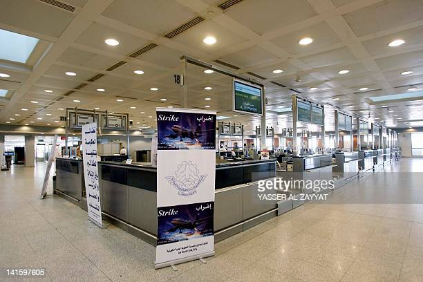 Kuwait Airways counters are empty of employees go on strike demanding an increase in salaries and benefits at Kuwait's International Airport in...