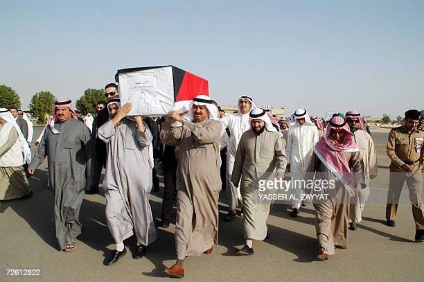 Kuwaiti mourners carry the coffin of one of three Kuwaitis found recently in a mass grave in Iraq during a funeral 21 November 2006 at a cemetary in...