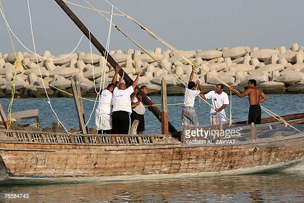 Kuwaiti pearl divers fix a dhow 21 July 2007 during preparations in Kuwait City for the upcoming annual pearl diving season Pearldiving trips are...
