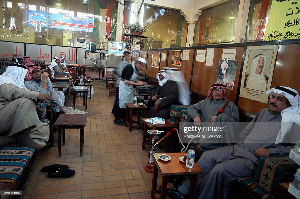 Kuwaitis smoke the narghile at a traditional coffee shop in downtown Kuwait City 18 January 2006 after companies and shops resumed business as usual...