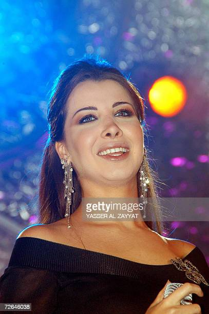 Lebanese singer Nancy Ajram performs during a private concert in Kuwait City late 25 November 2006 AFP PHOTO/YASSER ALZAYYAT