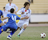 CITY Kuwait Japan Under22 forward Takashi Usami seeks to escape his markers during the second half of a friendly soccer match against the Kuwait...