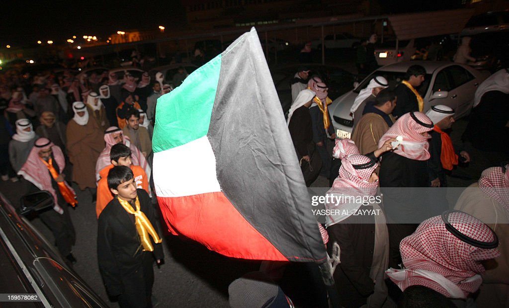 Kuwait opposition supporters take part in a demonstration to demand the dissolution of the parliament in al-Reqa district, South of Kuwait city on January 16, 2013. The parliament was elected last month in general polls that were boycotted by almost all political groups.