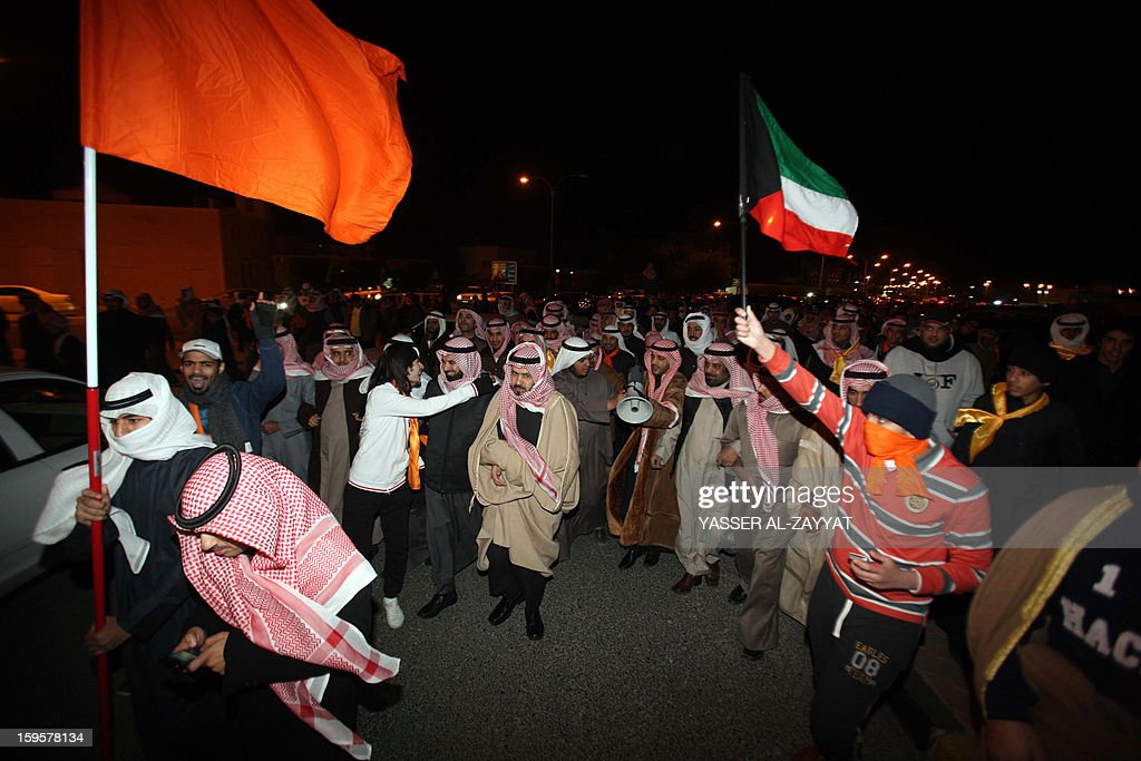 Kuwait opposition supporters take part in a demonstration to demand the dissolution of the parliament in al-Reqa district, South of Kuwait city on January 16, 2013. The parliament was elected last month in general polls that were boycotted by almost all political groups. AFP PHOTO / YASSER AL-ZAYYAT