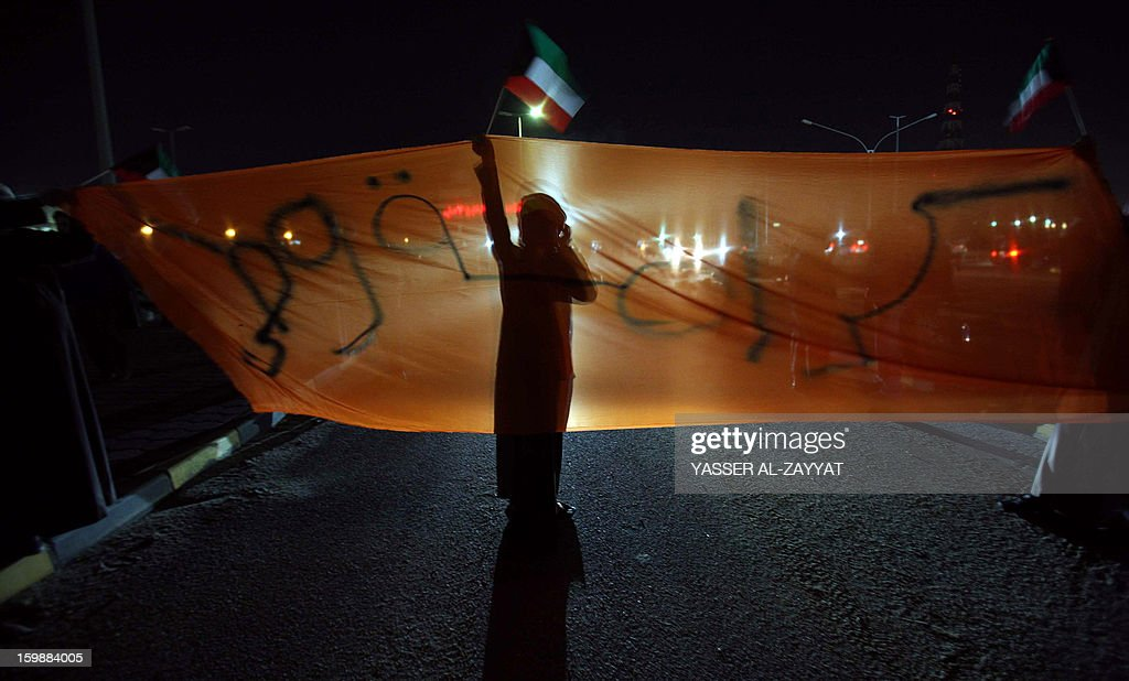 Kuwait opposition supporters take part in a demonstration to demand the dissolution of the parliament in al-Sabahiya district, in southern Kuwait city, on January 22, 2013. The parliament was elected last month in general polls that were boycotted by almost all political groups.