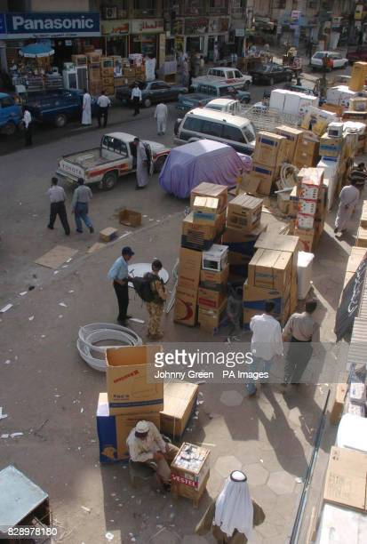 Kuwait Street in central Basra in southern Iraq where hoards of brand new television sets satellite dishes washing machines and fridgefreezers are...