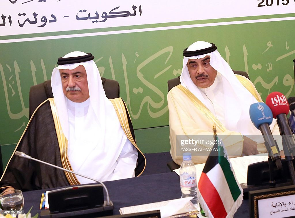 Kuwaiti deputy Prime Minister and Foreign Affairs Minister Sheikh Sabah al-Khaled al-Sabah (R) and Saudi Finance Minister, Ibrahim al-Assaf attend a meeting of Arab Financial Institutions on April 7, 2015 in Kuwait City.