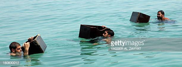 Kuwaiti divers search for shells containing pearls in the port of Khairan 100 kilometres south of Kuwait City on August 27 2012 Pearldiving trips are...