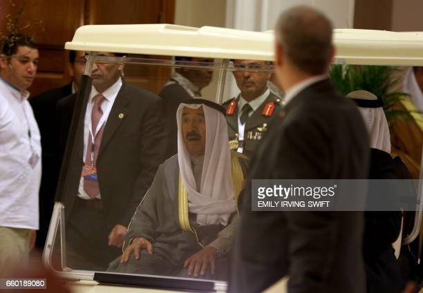 Kuwaiti Emir Sabah alAhmad alJaber alSabah rides in a golf buggy during the Arab League summit in the Jordanian Dead Sea resort of Sweimeh on March...