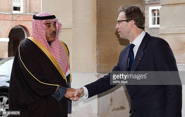 Kuwaiti foreign minister Khalid AlJarallah is greeted by Foreign Office minister Tobias Ellwood as he arrives for a meeting with coalition members to...