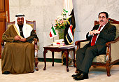 Kuwaiti Foreign Minister Sheikh Mohammed alSabah is greeted by his Iraqi counterpart Hoshyar Zebari at his official office on February 26 2009 in...