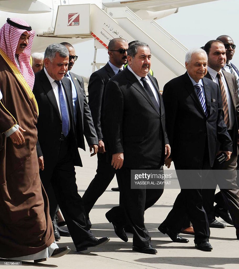Kuwaiti Foreign Minister Sheikh Sabah al-Khaled al-Sabah (L) receives Iraqi Foreign Minister Hoshyar Zebari (2R) upon his arrival at Kuwait International Airport in Kuwait City on February 27, 2013, on-board the first Iraqi airplane to land in Kuwait since the Iraqi invasion in 1990. Iraqi Airways will resume direct flights to Kuwait from February 16 after a 22-year stoppage due to the Iraqi invasion of the Gulf state, a top Kuwaiti civil aviation official said.