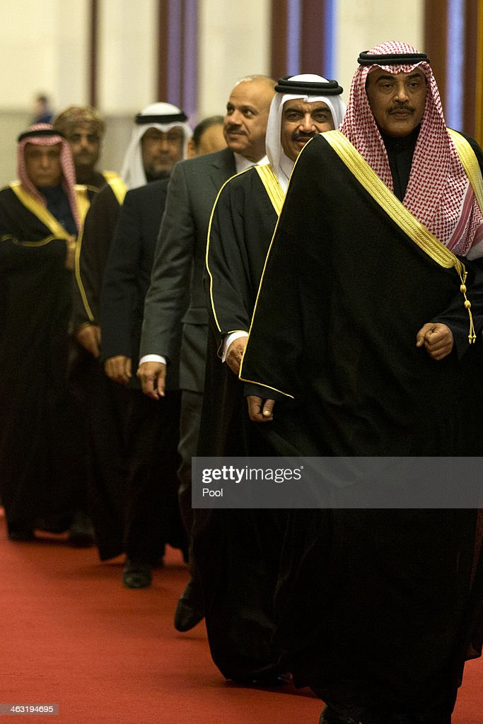 Kuwaiti Foreign Minister Sheikh Sabah Khaled al-Hamad Al-Sabah, front, leads a group of senior officials of the Gulf Cooperation Council (GCC) on their way to meet Chinese President Xi Jinping at the Great Hall of the People January 17, 2014 in Beijing, China. The GCC is meeting to adopt united policy on water consumption, power and trade.